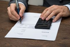 Businessperson checking invoice Royalty Free Stock Images