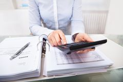 Businessperson checking an invoice in office Royalty Free Stock Image