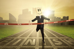 Businessperson crossing the finish line Stock Images