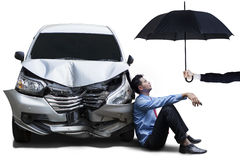 Businessperson with dented car and umbrella Royalty Free Stock Photos