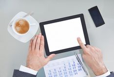 Businessperson with digital tablet and calendar Royalty Free Stock Images