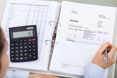 Businessperson With Document And Calculator Royalty Free Stock Images