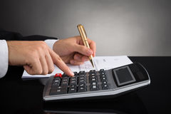 Businessperson Doing Calculation Royalty Free Stock Photo
