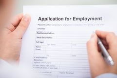 Businessperson with employment form Stock Photo