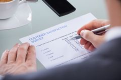 Businessperson filling survey form Stock Images