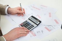 Businessperson hand calculating bills Royalty Free Stock Images