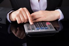 Businessperson Hand On Calculator Stock Image