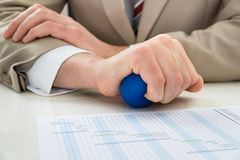 Businessperson hand with stressball Stock Images
