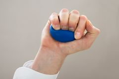 Businessperson hand with stressball Royalty Free Stock Photo
