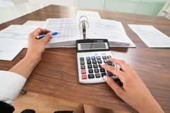 Businessperson hands calculating bill Royalty Free Stock Images
