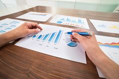 Businessperson hands with graphs Stock Images