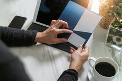 Businessperson Hands holding New Gift Card or Credit card,digita. L tablet computer dock keyboard,smart phone on marble desk,filter effect Royalty Free Stock Image