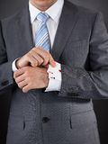 Businessperson Hiding Poker Card Stock Photography