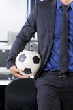 Businessperson holding ball in office Royalty Free Stock Photo