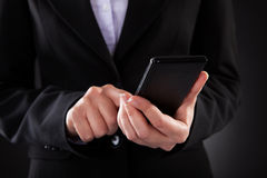 Businessperson Holding Cellphone Stock Photos