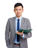 Businessperson holding clipboard Royalty Free Stock Images