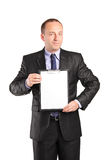 Businessperson holding a clipboard. Isolated on white background Royalty Free Stock Images