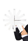 Businessperson holding clock Stock Images