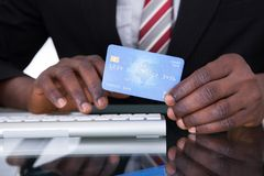 Businessperson Holding Credit Card Stock Photography