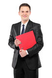A businessperson holding a folder Royalty Free Stock Image