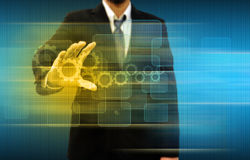 Businessperson holding gears and button  touch screen Stock Image