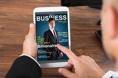 Businessperson holding mobile phone with news Stock Image