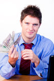 Businessperson holding money Stock Photo