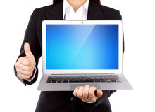 Businessperson holding an open laptop with thumb up. Isolated on white background Royalty Free Stock Image