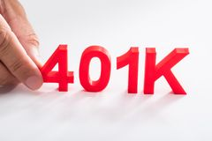 Businessperson holding 401k pension plan. Businessperson holding red 401k pension plan on white background stock photo