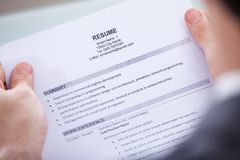 Businessperson holding resume Stock Images