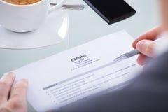 Businessperson holding resume Stock Photo
