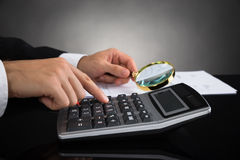 Businessperson Inspecting Invoice Royalty Free Stock Photo