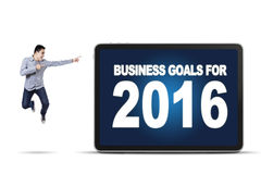 Businessperson jumping and showing business goals for 2016 Stock Photos
