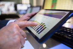 Businessperson Looking At Financial Graph On Digital Tablet. Close-up Of A Businessperson`s Hand Looking At Financial Graph On Digital Tablet In Office stock photos