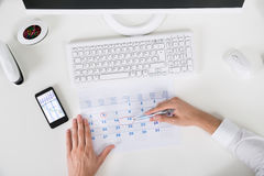 Businessperson Marking Important Date On Calendar Royalty Free Stock Image