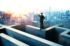 Businessperson on maze wall Royalty Free Stock Photography