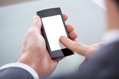 Businessperson met mobiele telefoon Stock Afbeeldingen