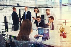 Businessperson in office connected on internet network. concept of partnership and teamwork. Businessperson in a modern office connected on internet network Royalty Free Stock Photo