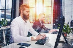 Businessperson in office connected on internet network. concept of partnership and teamwork. Businessperson in a modern office connected on internet network Stock Photography