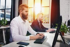 Businessperson in office connected on internet network. concept of partnership and teamwork. Businessperson in a modern office connected on internet network Royalty Free Stock Photography