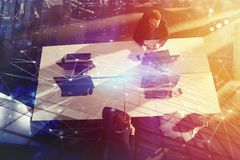Businessperson in office with network effect. concept of partnership and teamwork. double exposure Stock Photo