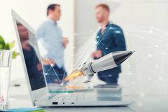 Businessperson in office work for a startup of a company with a rocket. Concept of partnership and teamwork Royalty Free Stock Photos