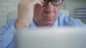 Businessperson In Office Work Using a Laptop make Financial Calculations stock photo