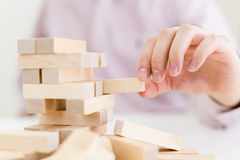 Businessperson playing with blocks royalty free stock image