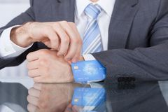 Businessperson Removing Credit Card From Sleeve. Close-up Of Businessperson Removing Credit Card From Suit Sleeve Royalty Free Stock Photo