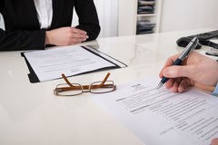 Businessperson With Resume And Pen Stock Photo