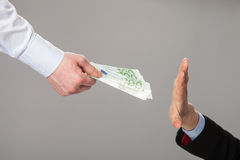 Businessperson's hand rejecting an offer of money Stock Images