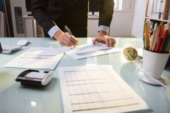 Businessperson Working On Financial Graph royalty free stock photography