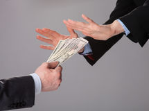 Businessperson's hands rejecting an offer of money Stock Images
