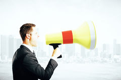 Businessperson screaming into megaphone Royalty Free Stock Images